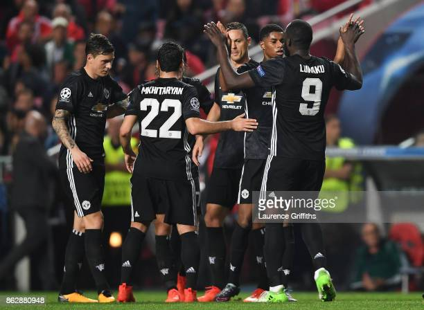Marcus Rashford of Manchester United celebrates scoring his sides first goal with his Manchester United team mates during the UEFA Champions League...