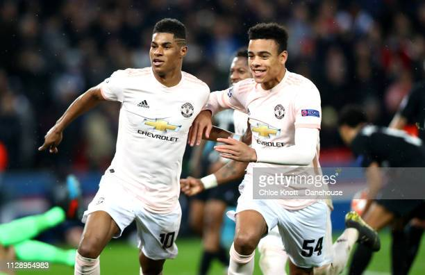 Marcus Rashford of Manchester United celebrates scoring his team's third goal with Mason Greenwood during the UEFA Champions League Round of 16...