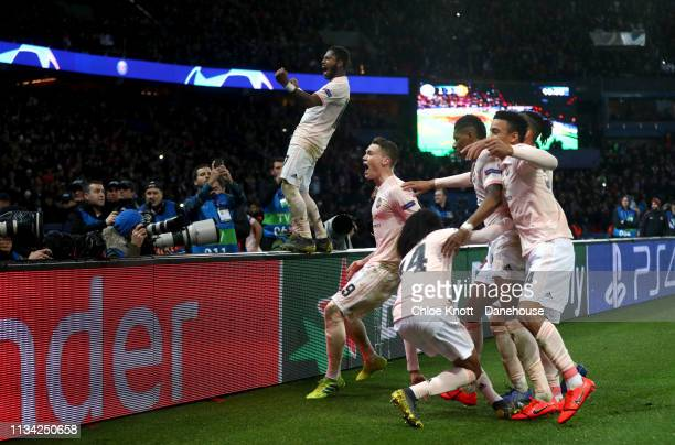 PARIS FRANCE MARCH 06 Marcus Rashford of Manchester United celebrates scoring his teams third goal with his team mates which was a penalty during the...