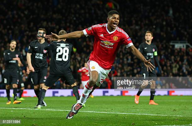 Marcus Rashford of Manchester United celebrates scoring his team's third goal during the UEFA Europa League Round of 32 second leg match between...