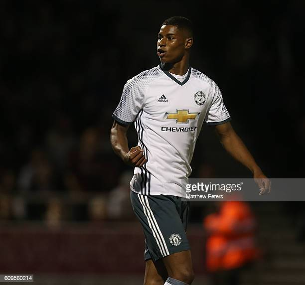Marcus Rashford of Manchester United celebrates scoring his team's third goal during the EFL Cup Third Round match between Northampton Town and...