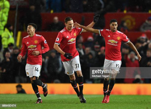 Marcus Rashford of Manchester United celebrates scoring the 1st Manchester United goal with Nemanja Matic and Jesse Lingard during the Premier League...