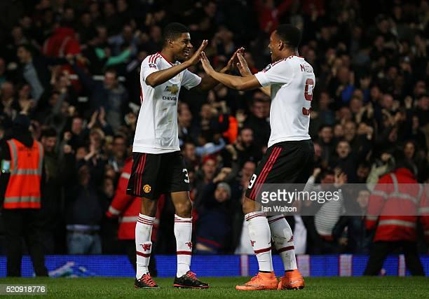Marcus Rashford of Manchester United celebrates scoring the opening goal with Anthony Martial of Manchester United during The Emirates FA Cup sixth...