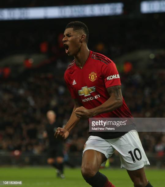 Marcus Rashford of Manchester United celebrates scoring their first goal during the Premier League match between Tottenham Hotspur and Manchester...