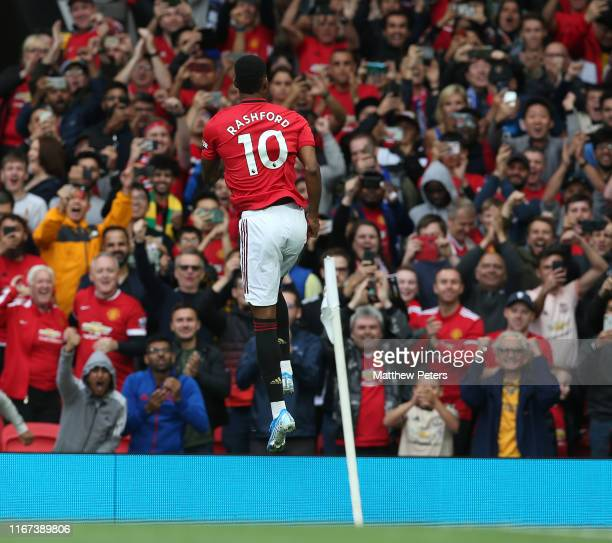 Marcus Rashford of Manchester United celebrates scoring their first goal during the Premier League match between Manchester United and Chelsea FC at...