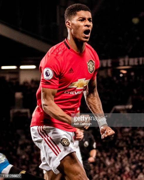 Marcus Rashford of Manchester United celebrates scoring their first goal during the Premier League match between Manchester United and Aston Villa at...