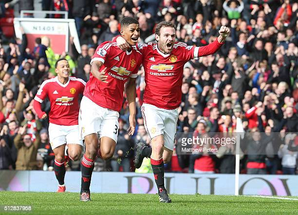 Marcus Rashford of Manchester United celebrates scoring their first goal during the Barclays Premier League match between Manchester United and...
