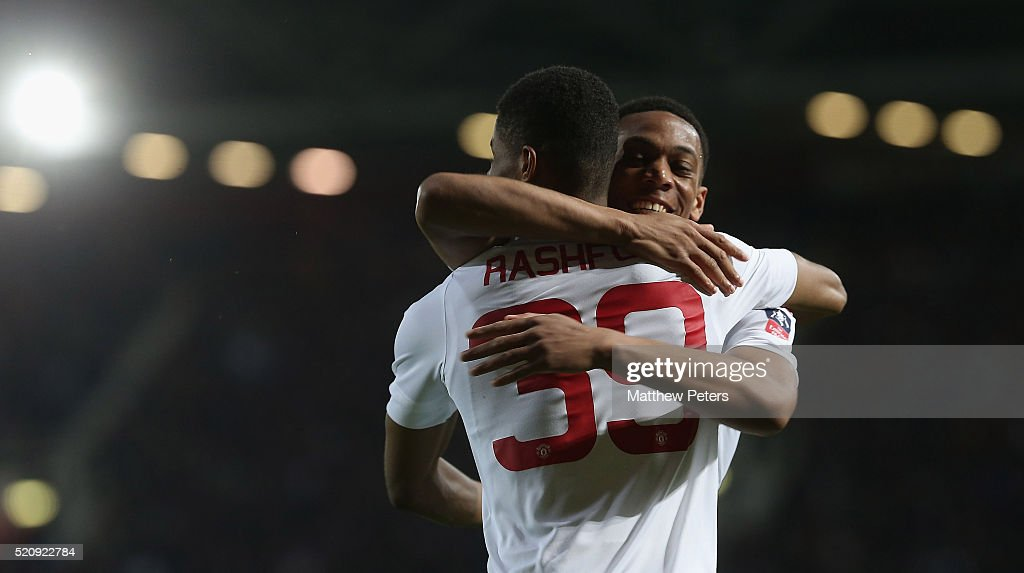 Marcus Rashford of Manchester United celebrates scoring their first goal during the Emirates FA Cup Sixth Round replay match between West Ham United and Manchester United at Boleyn Ground on April 13, 2016 in London, England.