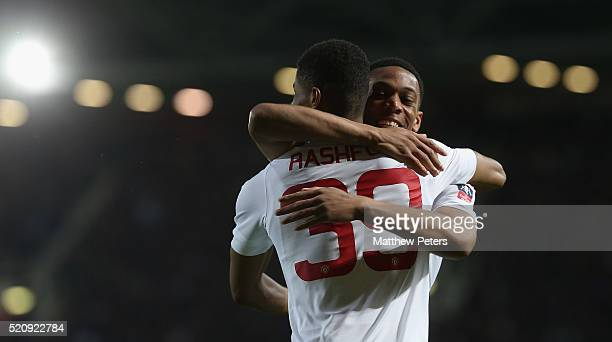 Marcus Rashford of Manchester United celebrates scoring their first goal during the Emirates FA Cup Sixth Round replay match between West Ham United...