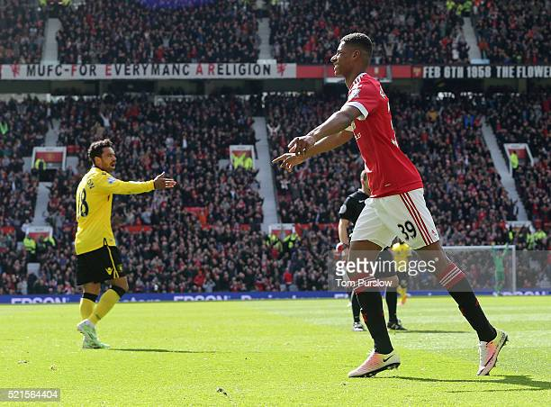 Marcus Rashford of Manchester United celebrates scoring their first goal during the Barclays Premier League match between Manchester United and Aston...