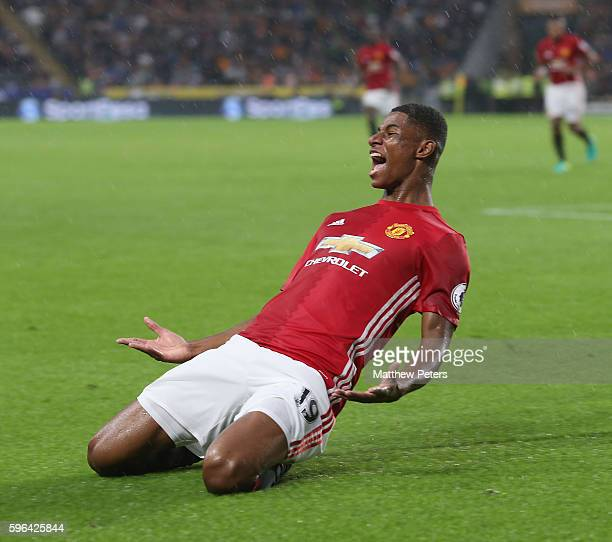 Marcus Rashford of Manchester United celebrates scoring their first goal during the Premier League match between Manchester United and Hull City at...