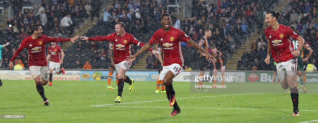 Marcus Rashford of Manchester United celebrates scoring their first goal during the Premier League match between Manchester United and Hull City at KC Stadium on August 27, 2016 in Hull, England.