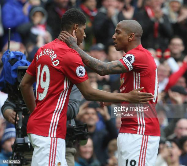 Marcus Rashford of Manchester United celebrates scoring their first goal during the Premier League match between Manchester United and Chelsea at Old...