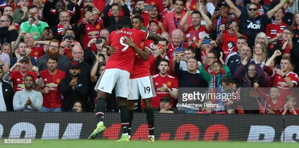 Marcus Rashford of Manchester United celebrates scoring their first goal during the Premier League match between Manchester United and Leicester City...
