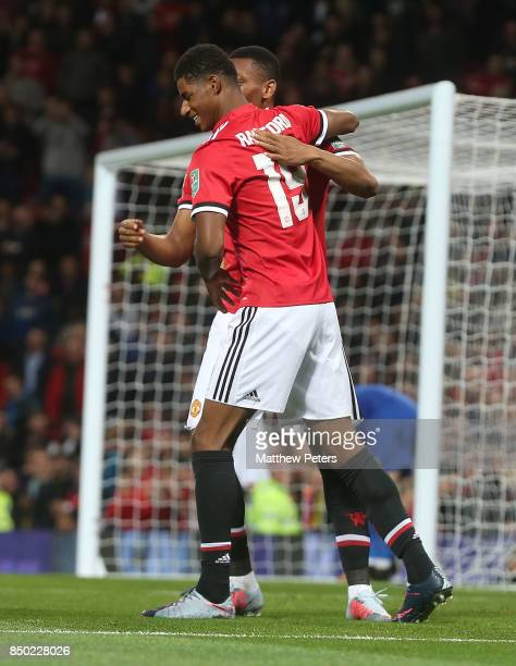 Marcus Rashford of Manchester United celebrates scoring their first goal during the Carabao Cup Third Round between Manchester United and Burton...