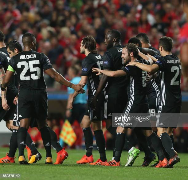 Marcus Rashford of Manchester United celebrates scoring their first goal during the UEFA Champions League group A match between SL Benfica and...