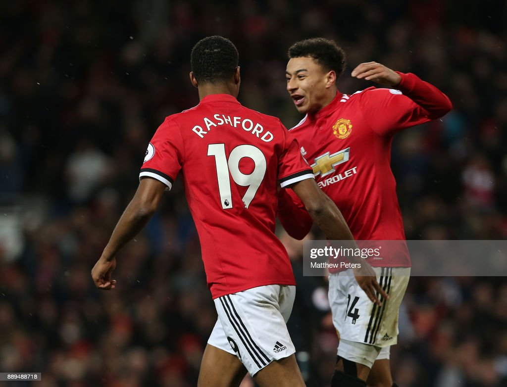 Marcus Rashford of Manchester United celebrates scoring their first goal during the Premier League match between Manchester United and Manchester City at Old Trafford on December 10, 2017 in Manchester, England.