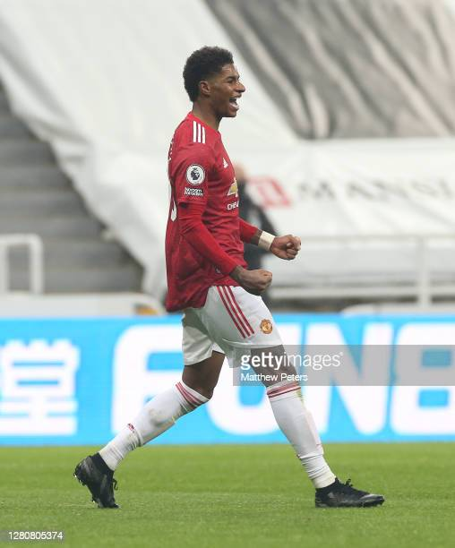Marcus Rashford of Manchester United celebrates scoring their fourth goal during the Premier League match between Newcastle United and Manchester...