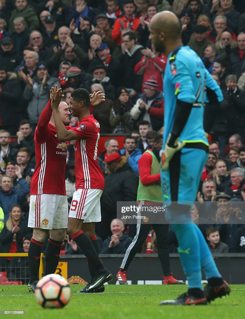 Marcus Rashford of Manchester United celebrates scoring their fourth goal during the Emirates FA Cup Third Round match between Manchester United and Reading at Old Trafford on January 7, 2017 in Manchester, England.