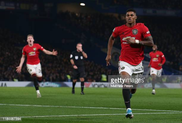 Marcus Rashford of Manchester United celebrates scoring their second goal during the Carabao Cup Round of 16 match between Chelsea FC and Manchester...