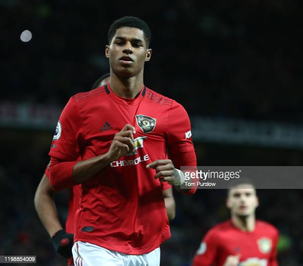 Marcus Rashford of Manchester United celebrates scoring their second goal during the Premier League match between Manchester United and Norwich City...
