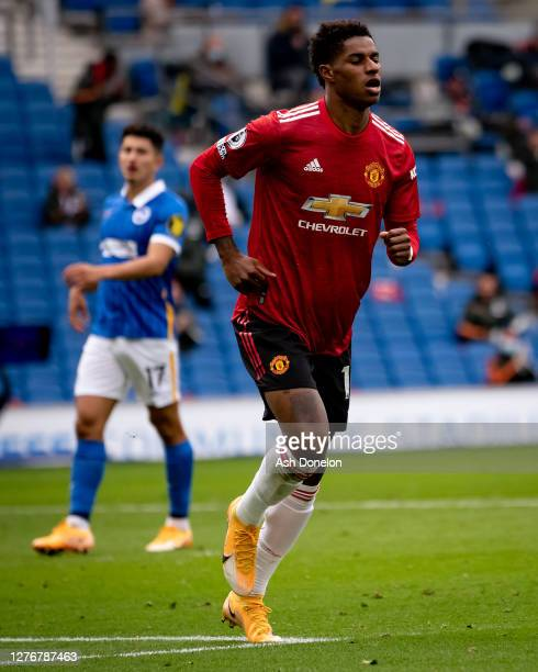Marcus Rashford of Manchester United celebrates scoring their second goal during the Premier League match between Brighton & Hove Albion and...