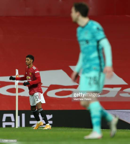 Marcus Rashford of Manchester United celebrates scoring their second goal during the Emirates FA Cup Fourth Round match between Manchester United and...