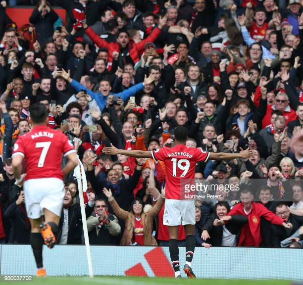 Marcus Rashford of Manchester United celebrates scoring their second goal during the Premier League match between Manchester United and Liverpool at...