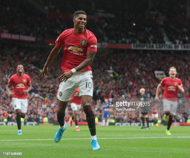 Marcus Rashford of Manchester United celebrates scoring their third goal during the Premier League match between Manchester United and Chelsea FC at...