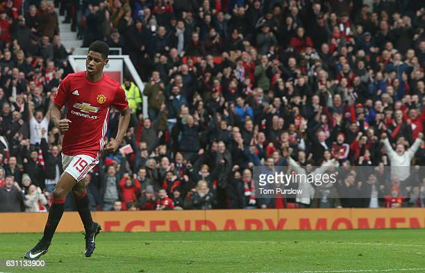 Marcus Rashford of Manchester United celebrates scoring their third goal during the Emirates FA Cup Third Round match between Manchester United and...
