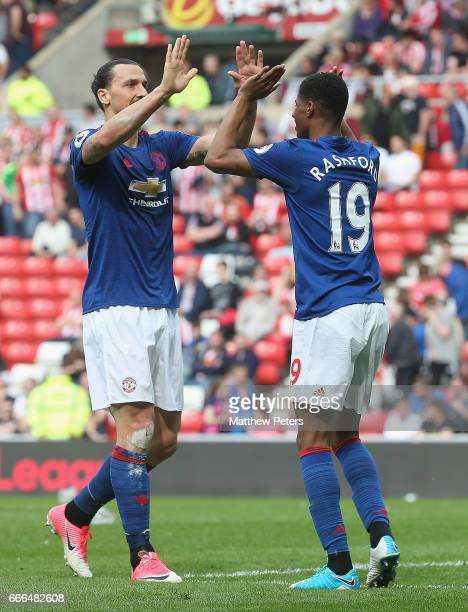 Marcus Rashford of Manchester United celebrates scoring their third goal during the Premier League match between Sunderland and Manchester United at...