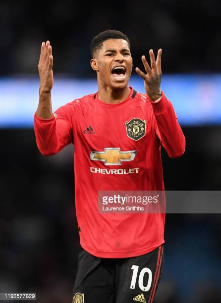 Marcus Rashford of Manchester United celebrates victory after the Premier League match between Manchester City and Manchester United at Etihad...