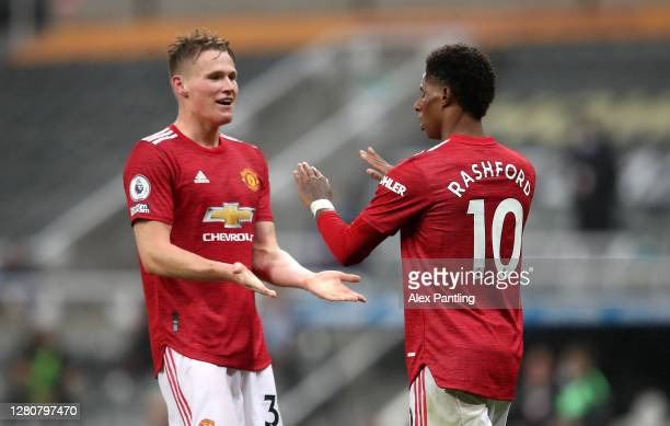 Marcus Rashford of Manchester United celebrates victory with Scott McTominay after the Premier League match between Newcastle United and Manchester...