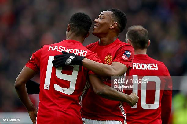 Marcus Rashford of Manchester United celebrates with Anthony Martial of Manchester United after scoring his first and his sides third goal during the...