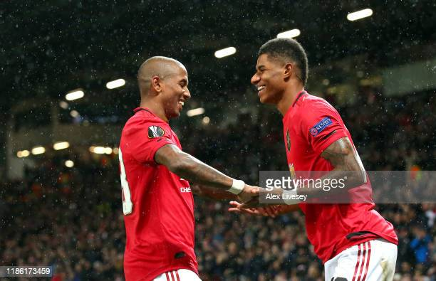 Marcus Rashford of Manchester United celebrates with Ashley Young after scoring his team's third goal during the UEFA Europa League group L match...
