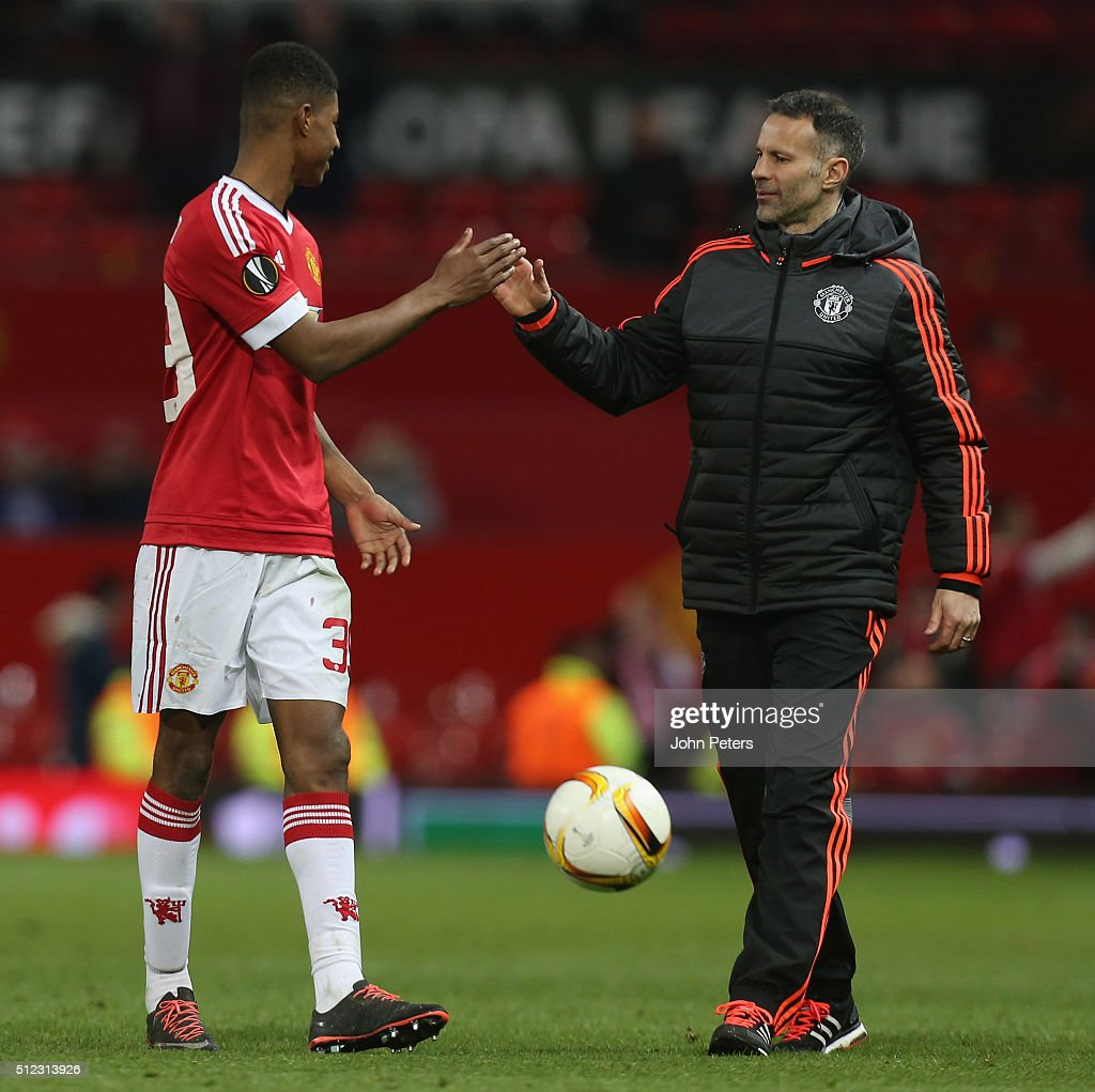 Marcus Rashford of Manchester United celebrates with Assistant Manager Ryan Giggs after the UEFA Europa League match between Manchester United and FC Midtjylland at Old Trafford on February 25, 2016 in Manchester, United Kingdom.