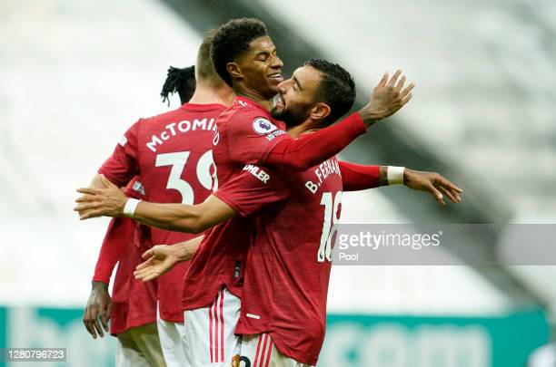 Marcus Rashford of Manchester United celebrates with Bruno Fernandes after scoring his team's fourth goal during the Premier League match between...