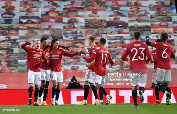 Marcus Rashford of Manchester United celebrates with Donny Van De Beek, Edinson Cavani and team mates after scoring their side's second goal during...