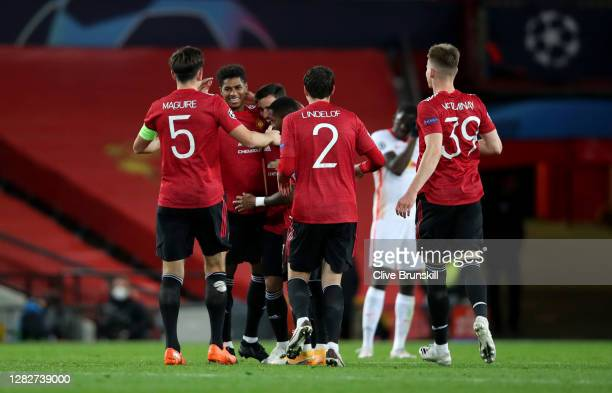 Marcus Rashford of Manchester United celebrates with his team mates after scoring his sides second goal during the UEFA Champions League Group H...