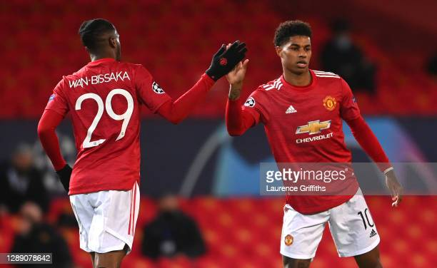 Marcus Rashford of Manchester United celebrates with team mate Aaron Wan-Bissaka after scoring their sides first goal during the UEFA Champions...