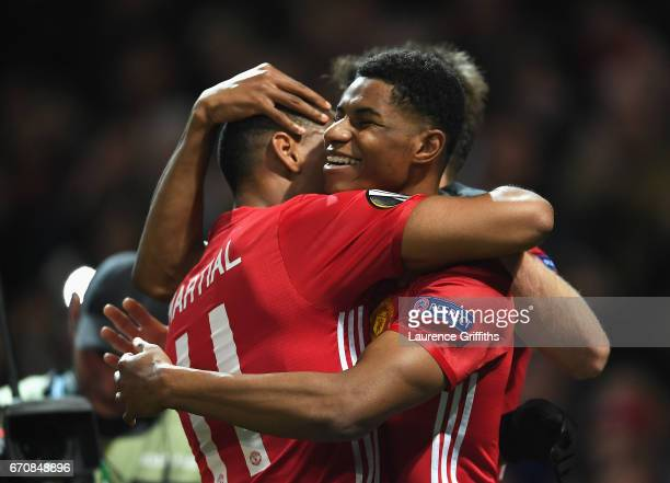 Marcus Rashford of Manchester United celebrates with team mate Anthony Martial as he scores their second goal during the UEFA Europa League quarter...