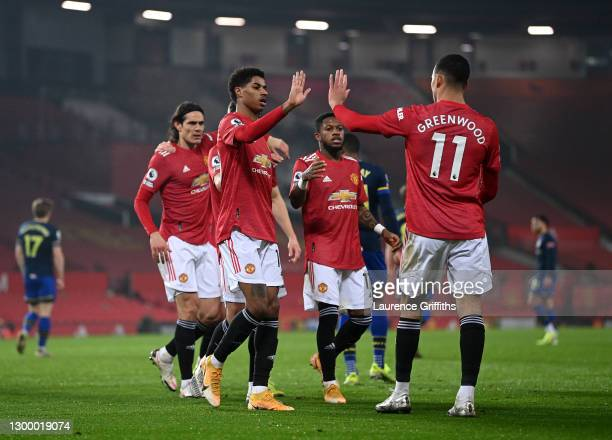 Marcus Rashford of Manchester United celebrates with team mate Mason Greenwood after scoring their side's second goal during the Premier League match...