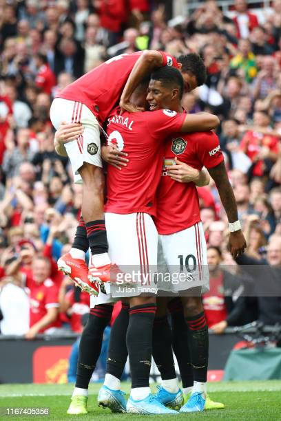 Marcus Rashford of Manchester United celebrates with team mates after scoring his team's third goal during the Premier League match between...