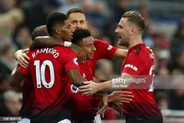 Marcus Rashford of Manchester United celebrates with team mates Luke Shaw Nemanja Matic and Jesse Lingard of Manchester United after scoring their...