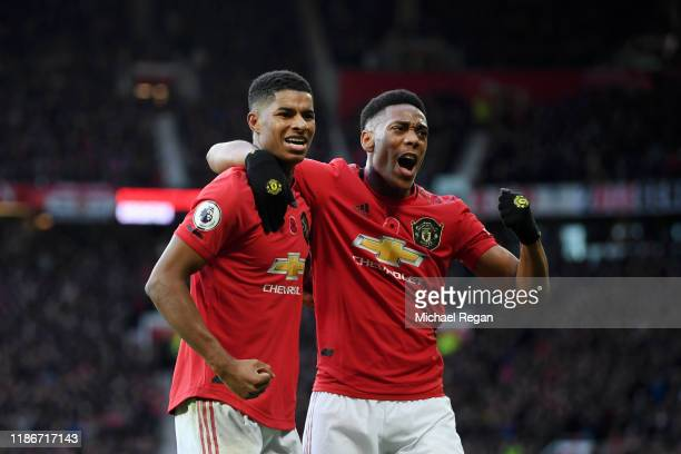 Marcus Rashford of Manchester United celebrates with teammate Anthony Martial after scoring his team's third goal during the Premier League match...