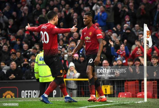 Marcus Rashford of Manchester United celebrates with teammate Diogo Dalot after scoring his sides second goal during the Premier League match between...
