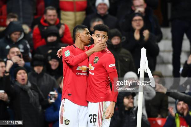 Marcus Rashford of Manchester United celebrates with teammate Mason Greenwood of Manchester United after scoring his sides first goal during the...
