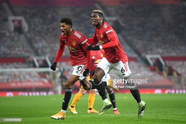 Marcus Rashford of Manchester United celebrates with teammate Paul Pogba after scoring his team's first goal during the Premier League match between...