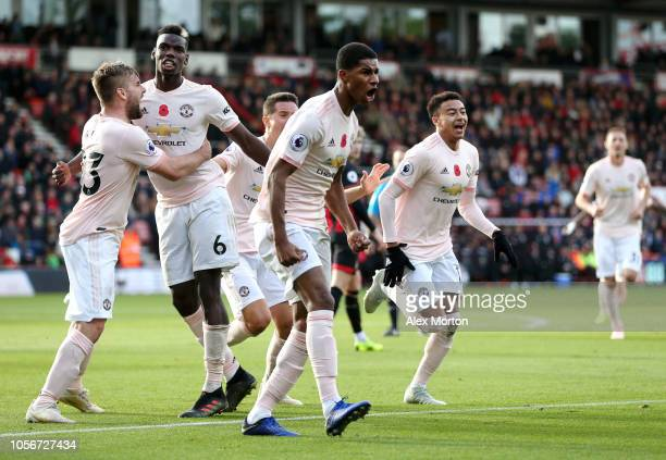 Marcus Rashford of Manchester United celebrates with teammates after scoring his team's second goal during the Premier League match between AFC...