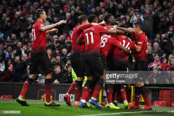 Marcus Rashford of Manchester United celebrates with teammates after scoring his sides second goal during the Premier League match between Manchester...